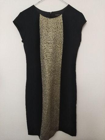 Dopasowana sukienka firmy Reserved