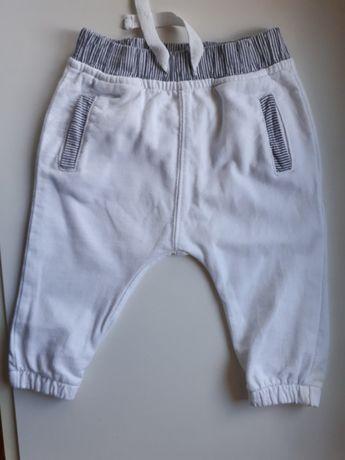 Spodnie białe chłopięce newbie by KappAhl 62