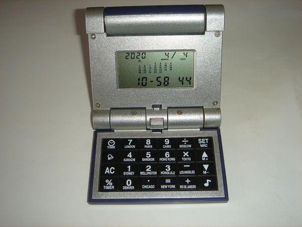Продам настольные часы с калькулятором.