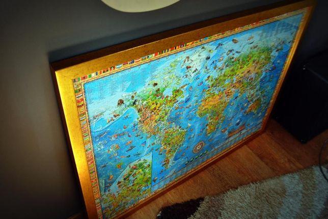 Obraz puzzle (z 3 tyś. puzzli) oprawiony w złotą ramkę. Na ścianę