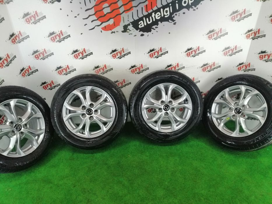"""Alufelgi """"16"""" 5x114,3 oryginał Mazda + opony 215/60/16 Dunlop Łuków - image 1"""
