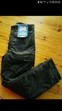 Nowe zimowe spodnie ocieplane robocze marki Blacklader S/M . C48