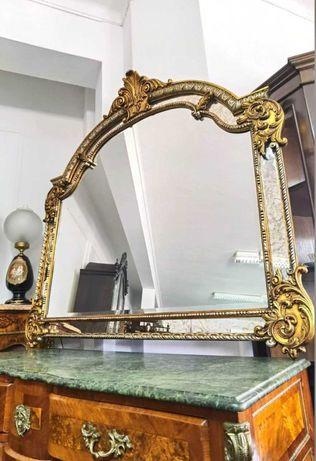 Imponente espelho em talha dourada