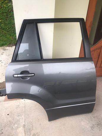 Suzuki Grand Vitara II. Drzwi prawa tyl. Kolor ZDL C09.
