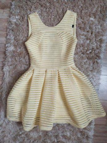 Sukienka żółta rozkloszowana