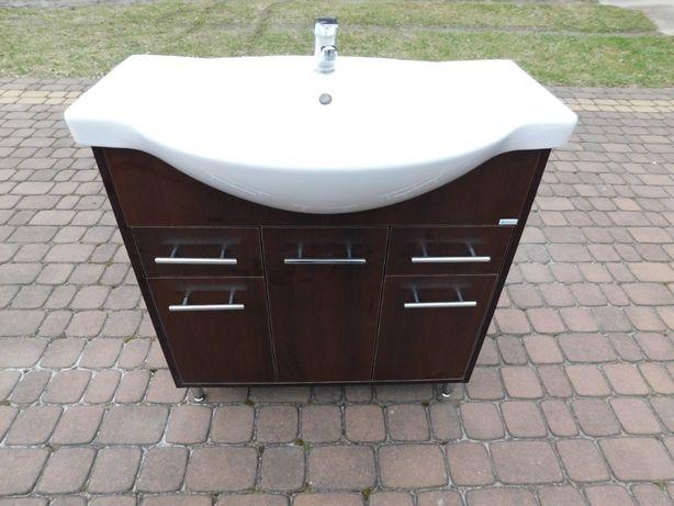 Szafka łazienkowa z umywalką, syfonem i baterią.