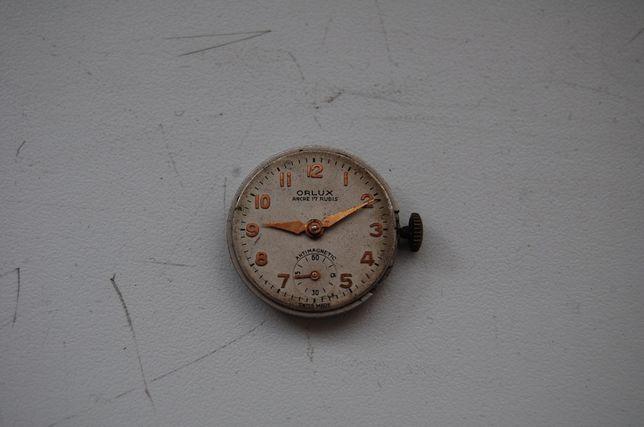 Zegarek, cyferblat. Szwajcarski mechanizm zegarkowy firmy Orlux.
