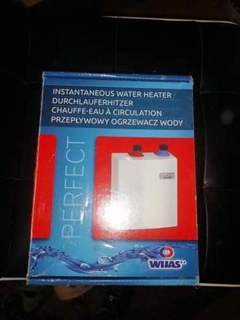 Na gwarancji przepływowy podgrzewacz wody 5KW