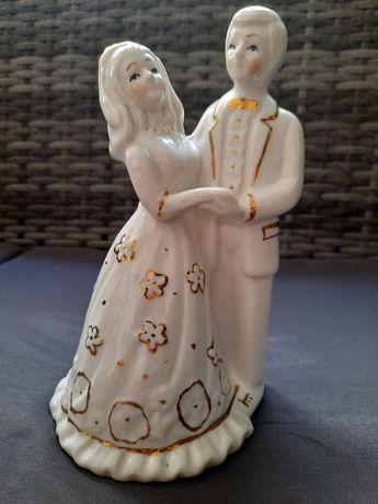 Casal de noivos em porcelana