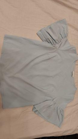 Очень красивая женская блузка нежно-голубого цвета