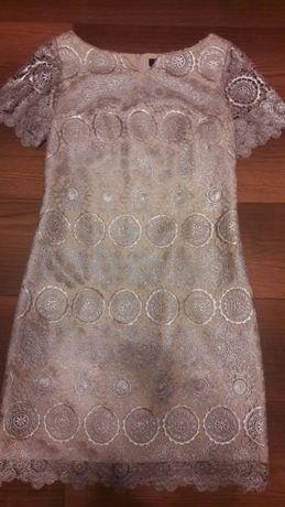 Piękna sukienka koronkowa w kolorze srebra. Rozm.38