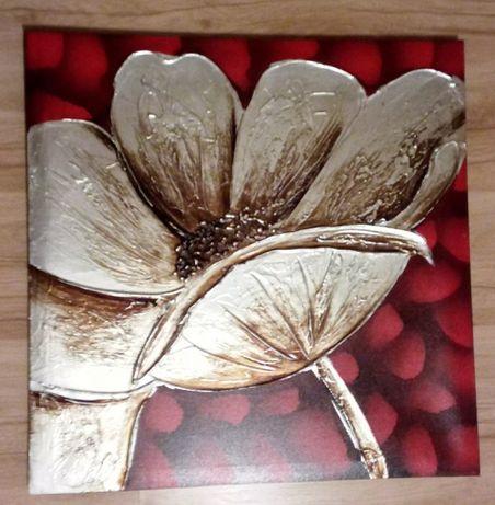 Obraz złoty kwiat na czerwonym tle
