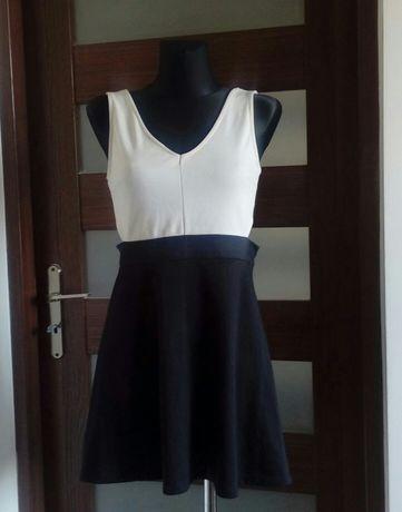 Sukienka rozkoszowana czarna wycięcia po bokach M 38 beżowa