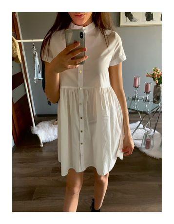 Biała koszulowa rozkloszowana sukienka zapisana na guziki XS S M