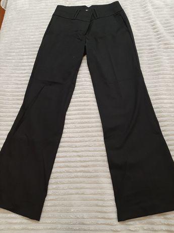 Czarne spodnie, wysoki stan, nogawka rozszerzona rozm 34 Orsay