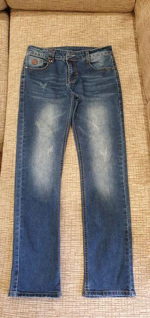 Продам джинсы на мальчика 164см