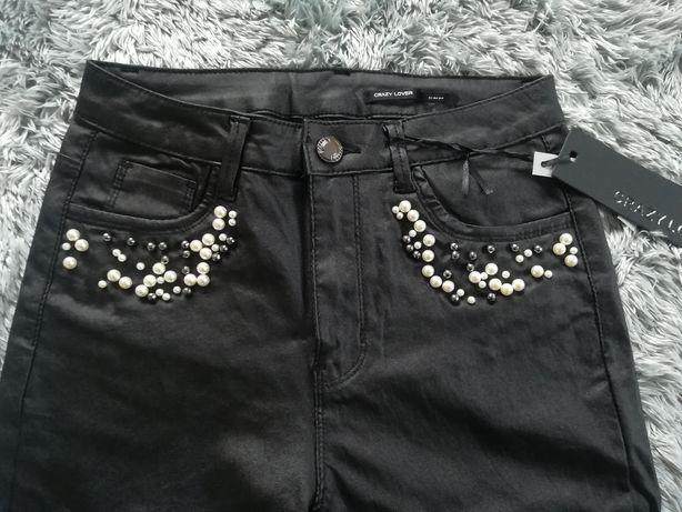 Nowe skóropodobne spodnie w rozmiarze 38