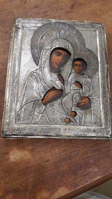 Икона старинная Божьей матери в серебряном окладе