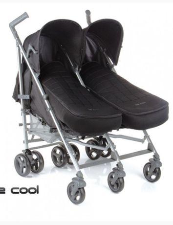 Прогулянкова коляска для двійнят