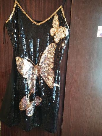 Платье з паєток.