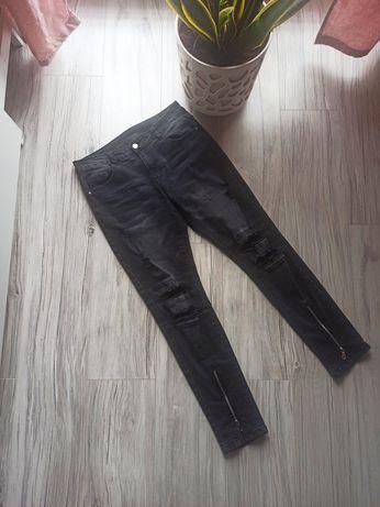 Spodnie jeans z rozdarciami rozmiar L