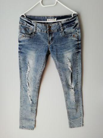 Spodnie rurki damskie z przetarciami L