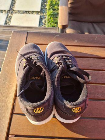 Продам роликові кросівки Heelys 35р  в чудовому стані