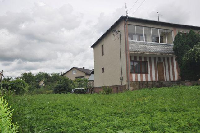 Продаж пів будинку з ділянкою 12 сот в спареному особняку на дві сім'ї