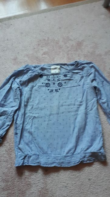 Dziewczęca niebieska elegancka bluzka z H&M.