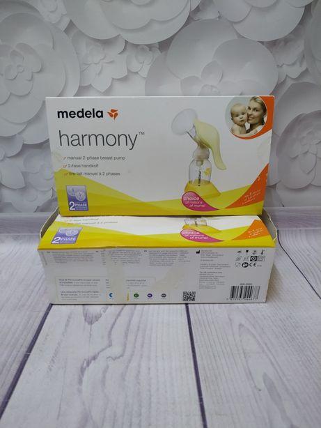 Молоковідсмоктувачів для ручного зціджування Medela Harmony