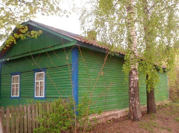 продам деревяні будинки в селі