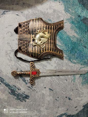 Tarcza rycerska i miecz.