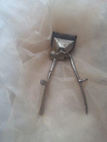 Парикмахерская машинка для стрижки.