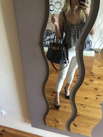 Beżowe elegnackie spodnie