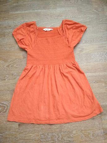 Колоритна оранжева футболка блуза
