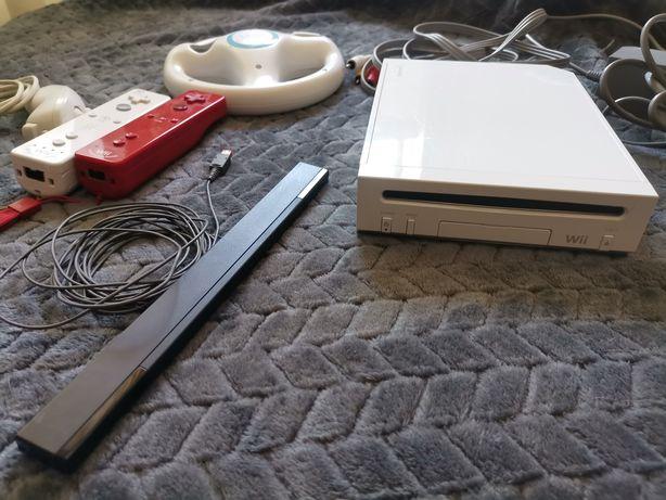 Nintendo Wii com comandos e três jogos