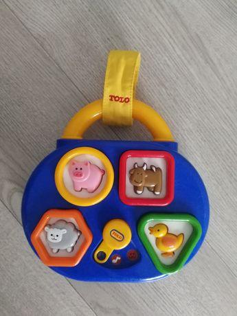 Музыкальная развивающая игрушка. Сортёр. Чемодан TOLO.