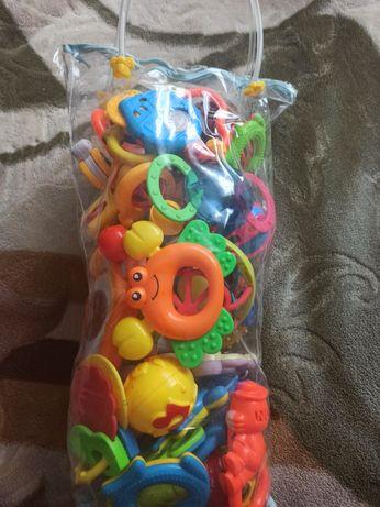 Дитячі іграшки брязкальця