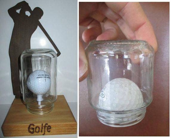 Bola de golfe dentro frasco