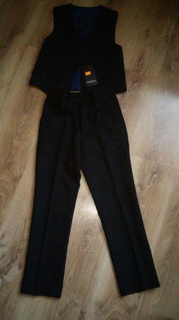 Spodnie i kamizelka 134