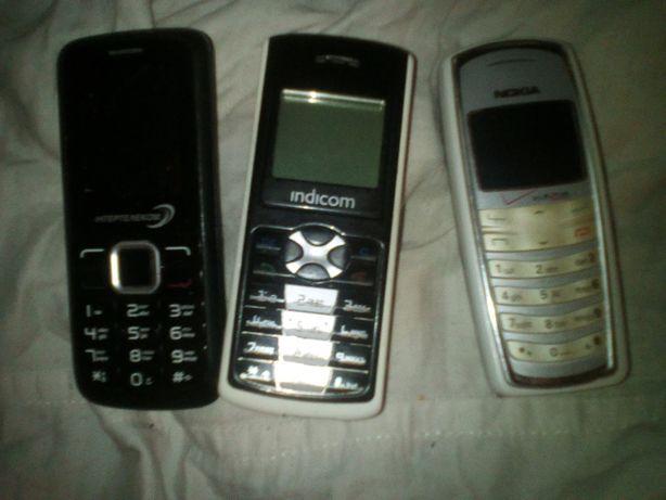Кнопочный мобильный телефон, б/у. GSM CDMA + номер к нему.