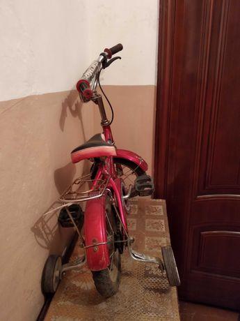 Велосипед с дополнительными калесами