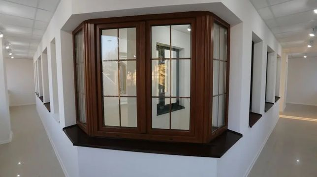 Двері Вікна металопластикові. Балкони. Підвіконники. Ламінат. Відливи