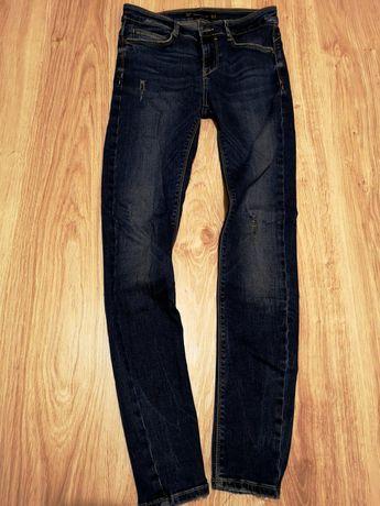 Tanio spodnie Zara