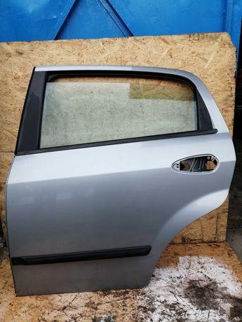Drzwi Fiat Grande Punto Lewy Tył 09r. 595/A ! !