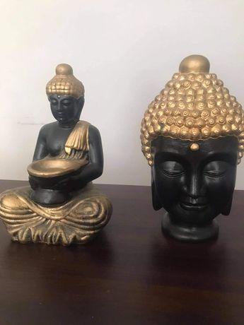 Estátuas budas em preto e dourado