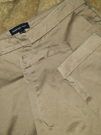 Beżowe Nude Camelowe eleganckie spodnie Mango S 36