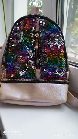 Рюкзак с пайетками для девочки.