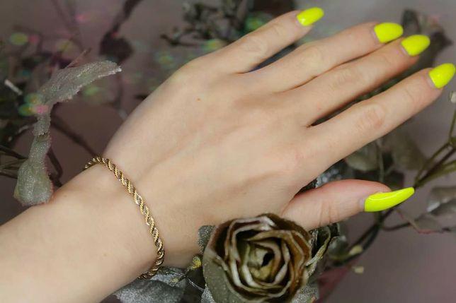Kręcona bransoletka w dwóch kolorach złota. Próba 0,585.