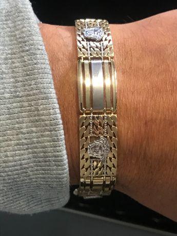 Złota bransoletka robiona na wzór versace
